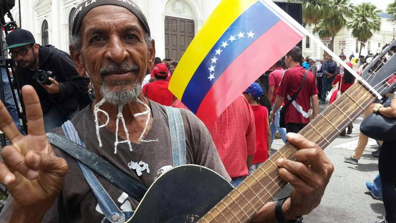 "Peace is on the minds of many Venezuelans. This man has his beard braided to form the word ""Paz,"" which means Peace in Spanish"