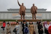 People pass to honor Kim Il Sung, founder of the DPRK worker's state.