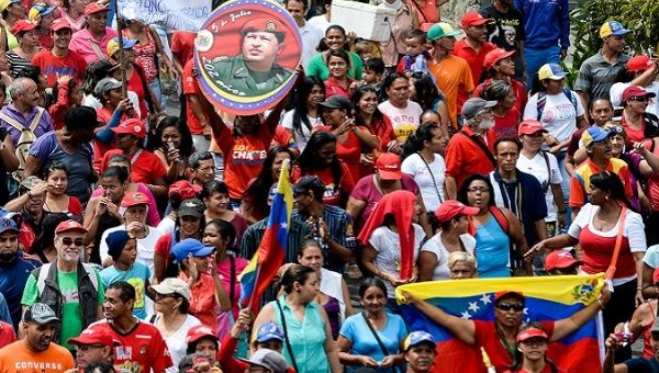 Venezuelans march in support of their Bolivarian Revolution.