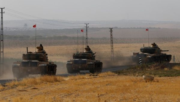 Turkish army tanks drive towards to the border in Karkamis on the Turkish-Syrian border in the southeastern Gaziantep province, Turkey, August 25, 2016.