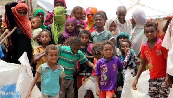 Displaced Yemenis gather outside makeshift shelters,  just a small part of the three million total according to U.N. figures.