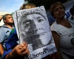 A woman holds a portrait of Milagro Sala outside the justice building in Buenos Aires, Argentina, Dec. 28, 2016.