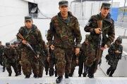 Brazilian soldiers hold weapons as they are deployed to provide security at the Corinthians arena in Sao Paulo.