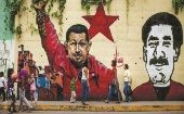 A mural of late President Hugo Chavez and current President Nicolas Maduro in Caracas.