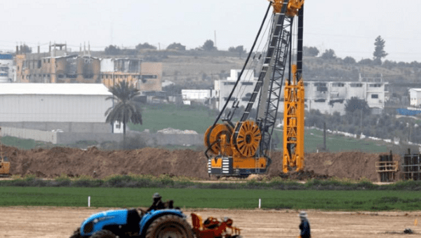 Heavy machinery can be seen at work along Israel