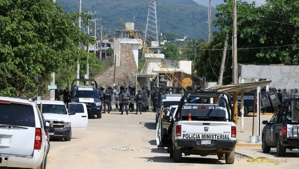 Riot police line up outside the prison in Acapulco, Mexico, on July 6, 2017.