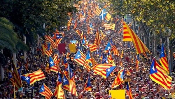 "People hold Catalan separatist flags known as ""Esteladas"" during a gathering to mark the Calatalonia day ""Diada"" in central Barcelona, Spain."