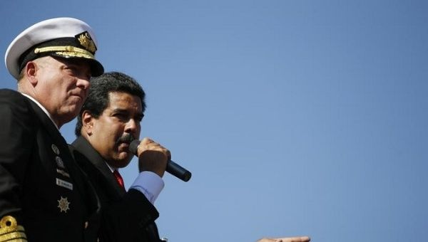 Nicolas Maduro stands next to then Defense Minister Diego Molero (L) at the Military Academy in Caracas March 7, 2013.