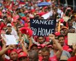 Venezuelan citizens march in support of President Nicolas Maduro.