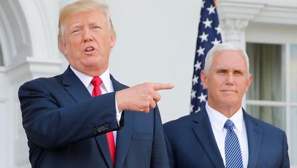 U.S. President Donald Trump speaks to reporters with Vice President Mike Pence at his side in Bedminster, New Jersey, U.S., on August 10, 2017.