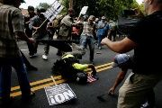 A man hits the pavement during a clash between members of white nationalist protesters and counter-demonstrators in Charlottesville, Virginia, U.S., August 12, 2017.