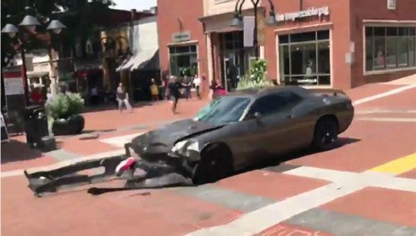 James Alex Fields Jr. quickly drives his sports car in reverse after ramming it into demonstrators protesting a white suprmeacist rally.