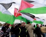 Palestinians take to the streets to celebrate the U.N. denunciation of illegal Israeli settlements.
