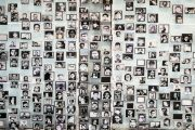 Victims of the Pinochet dictatorship displayed on a wall.