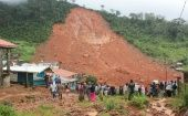 People inspect damage after a mudslide in the mountain town of Regent, Sierra Leone.