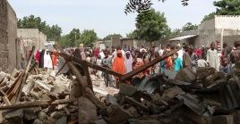 Residents gather at the scene of a bombing attack in Maiduguri, northeast Nigeria on July 17, 2017.