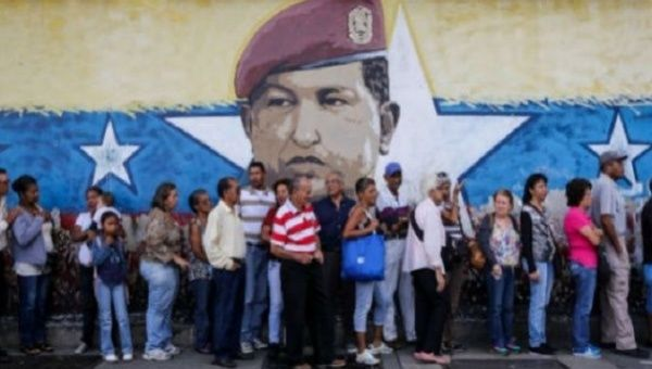 Voters line up to cast their ballot in Venezuela