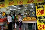 People shop in a grocery store in the city of Rio de Janeiro.