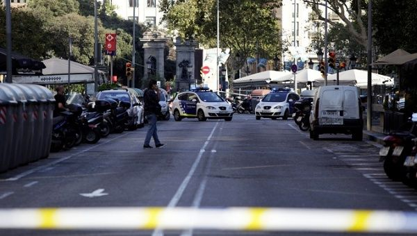 A street is cordoned off after a van crashed into pedestrians near Las Ramblas in Barcelona, Spain, Aug. 17, 2017.