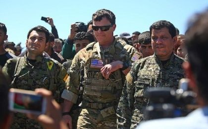 US officers visiting YPG officers at the site of Turkish airstrikes near northeastern Syrian Kurdish town of Derik on April 25, 2017.