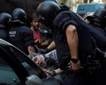 Police intervene as far right demonstrators and counter protesters scuffle on Las Ramblas in Barcelona, Spain, on August 18, 2017.