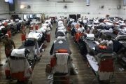 Inmates are housed in a gymnasium due to overcrowding at Chino State Prison in California.