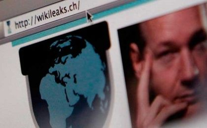 A screen shot of a web browser displaying the WikiLeaks website with a picture of its founder Julian Assange.