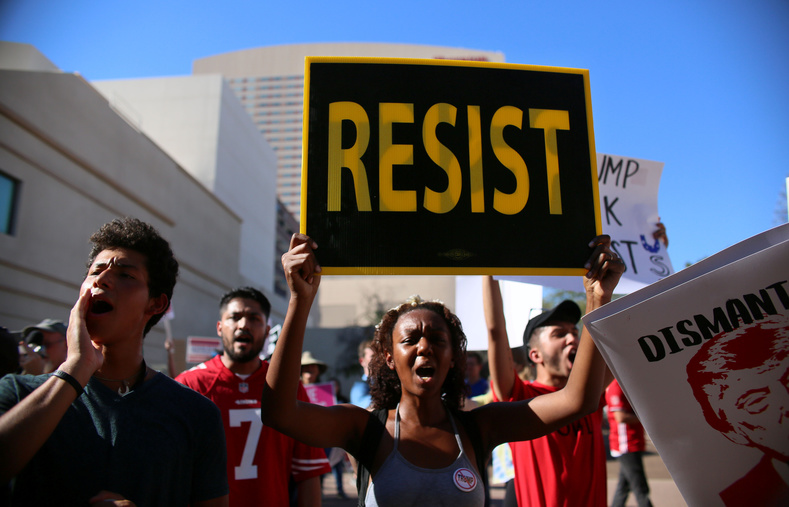 Resist. Many of the anti-Trump protesters oppose the growing racism in the United States since alt-right and hate groups began to feel more empowered