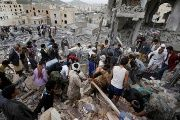 Local residents search through rubble following airstrikes that destroyed houses and killed at least a dozen in Sanaa, Yemen August 25, 2017.