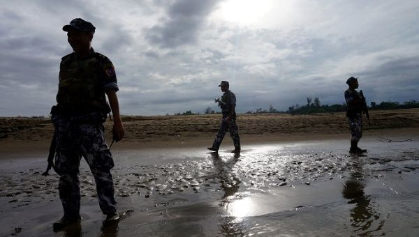A Myanmar border guard police officers stand guard in Buthidaung, northern Rakhine state, Myanmar, on July 13, 2017.