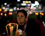 Members of the LGBTI community participate in a vigil in San Salvador, El Salvador, on June 18, 2016.