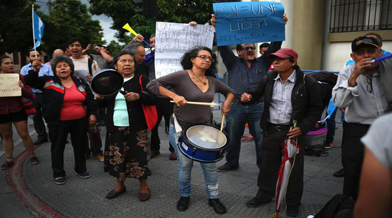 Protesters show their support for the head of the International Commission Against Impunity in Guatemala Ivan Velasquez. The Colombian born attorney