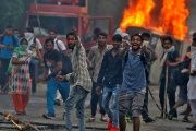 People on the streets during violence in the town of Panchkula, India, August 25, 2017