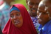 Relatives mourn following a deadly attack by U.S. and Somali forces that took the lives of 10, including three children.