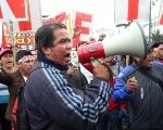 A teacher takes part in a protest in the capital city of Lima.