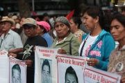 Relatives of the 43 disappeared students of Ayotzinapa during a march in Mexico City