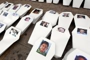 Paper coffins, symbolizing slain journalists, are seen lined up during a protest to demand justice for them in Tegucigalpa, Honduras, on April 11, 2016.