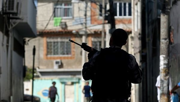 A police officer stands guard during a raid on the City of God favela, Rio de Janeiro, Brazil, November 20, 2016