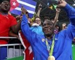 Men's Greco-Roman 130 kg winner Mijain Lopez of Cuba poses with his medal in Rio de Janeiro, Brazil.
