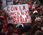 Venezuelans in support of the ANC with a sign that reads,