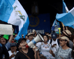 Demonstrators protest against Guatemalan President Jimmy Morales in front of the National Palace in Guatemala City, Guatemala, August 27, 2017.