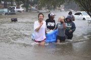 Houston residents trudge through floodwaters.