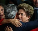 Dilma Rousseff embraces Senator Jorge Viana following her impeachment at at the Palace of Alborada in Brasilia, Brazil,August 31, 2016