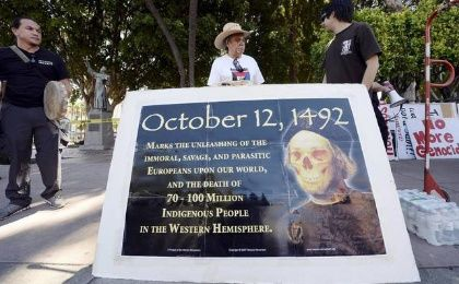 Olin Tezcatlipoca of the Mexica Movement stands with fellow protesters in an action against Father Junipero Serra.