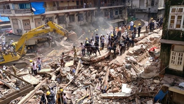 Firefighters and rescue workers search for survivors at the site of a collapsed building in Mumbai, India.