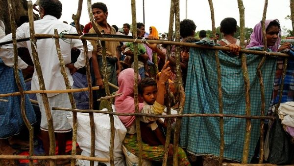New Rohingya refugees wait to enter the Kutupalang makeshift refugee camp, in Cox's Bazar, Bangladesh, Aug. 30, 2017.