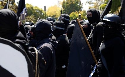 Masked counter-demonstrators gather against the cancelled No Marxism in America rally in Berkeley, California, U.S., on August 27, 2017.