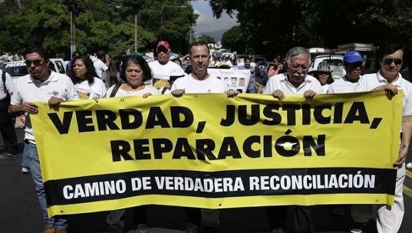 Victims and Relatives Canvass for War Crimes Reparations Law in El Salvador