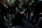 A Mapuche activist is detained during a protest in support of Santiago Maldonado.