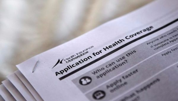 The federal government forms for applying for health coverage are seen at a rally held by supporters of the Affordable Care Act on October 4, 2013.